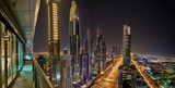 Dubai skyline during night with amazing city center lights and Sheikh Zayed road traffic,United Arab Emirates.