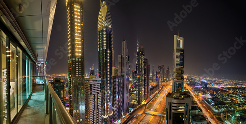 Poster Dubai skyline during night with amazing city center lights and Sheikh Zayed road traffic,United Arab Emirates.