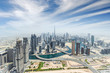 Leinwanddruck Bild - Aerial view of modern city skyscrapers in Dubai, UAE.