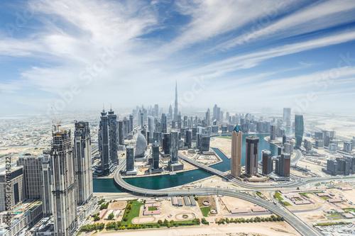 Leinwanddruck Bild Aerial view of modern city skyscrapers in Dubai, UAE.
