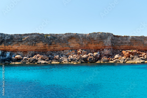 Rocky beach and turquoise water. Formentera Island. Spain