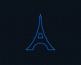 Neon light. Eiffel tower icon. Paris symbol. Glowing graphic design. Brick wall. Vector
