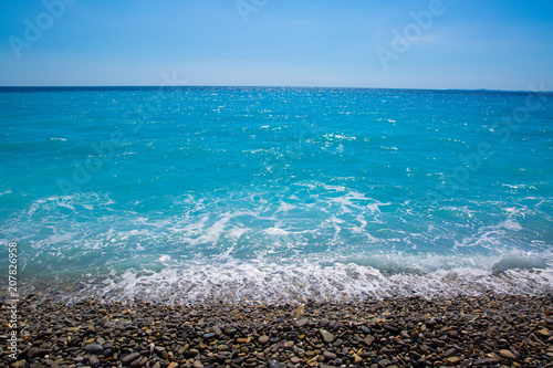 Fotobehang Nice Nice, beautiful beach, French Riviera, Cote d'Azur or Coast of Azure. Mediterranean sea.