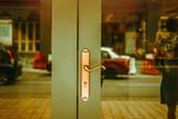 Green double doors with golden handle. Modern classic exterior design. Vintage tone filter effect - 207828966