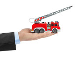 Hand with fire truck - 207836769