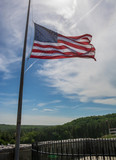 American flag at half staff in the sun - 207839362