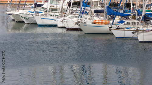 Sailboats and yachts on marine pier in Las Palmas, Spain. Nautical club, luxury transportation concept