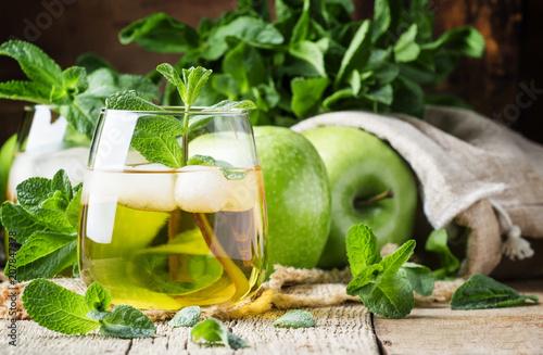 Fotobehang Sap Cold apple drink, vintage wooden background, selective focus