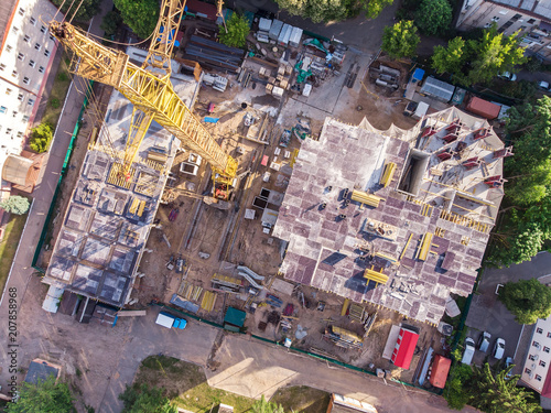 Foto Murales construction site with yellow tower crane shot from above. aerial photo
