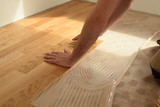 close up of worker installing wood parquet - 207879998