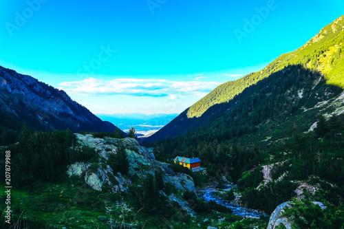 Fotobehang Turkoois Beautiful alpine high mountains peak, blue sky background. Amazing Mountain hiking paradise landscape, summertime.