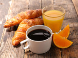coffee cup with croissant and orange juice - 207883355