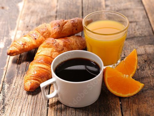 Leinwanddruck Bild coffee cup with croissant and orange juice