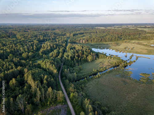 Fotobehang Bergrivier drone image. country lake surrounded by pine forest and fields from above