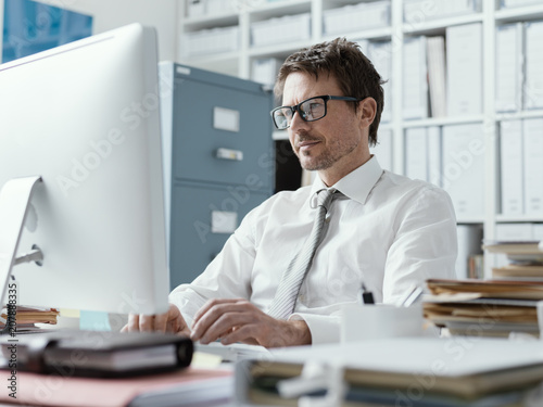 Confident business executive working in the office