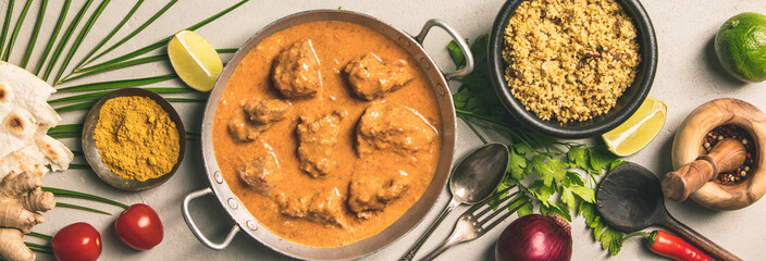 Traditional curry and ingredients on concrete background © Natalia Klenova