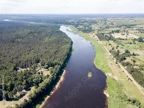 Fotobehang Beige drone image. aerial view of Daugava river, largest in Latvia