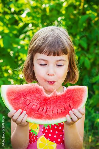 Foto Murales A child eats watermelon. Selective focus.