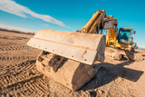road construction site - excavator for earth moving - 207897717