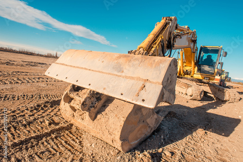 Foto Murales road construction site - excavator for earth moving