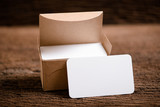 white blank business name card for mock up on wood background - 207897914