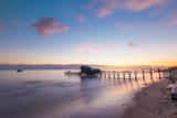Wide view of pier and house in the beach. - 207898774