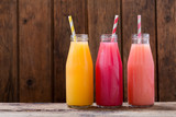 cold drinks in a botlles on wooden table - 207898970