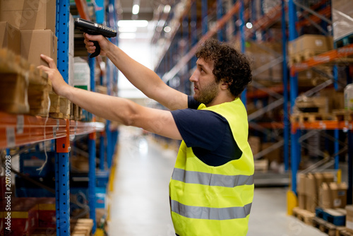 Scanning the goods in warehouse - 207909928