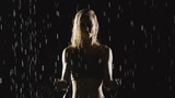 Athletic blond woman working out in the rain. Slow Motion - 207912961