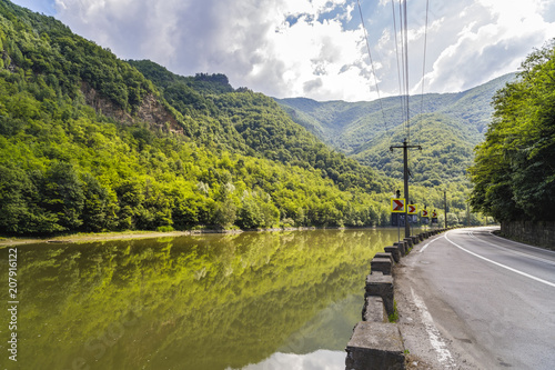 Fotobehang Zomer Highway going along the Olt river in Romania