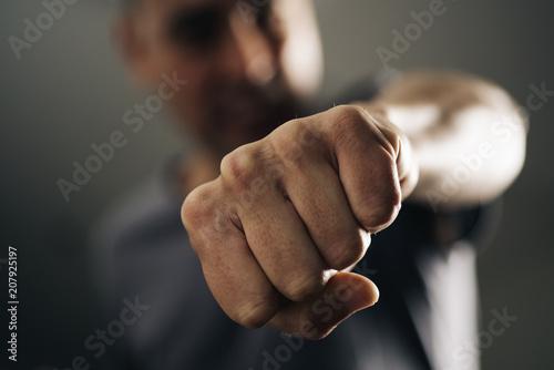 Leinwanddruck Bild young man throwing a punch.