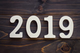 New year concept - Number 2019 for New Year on a wooden table. With vintage styled background. - 207927541
