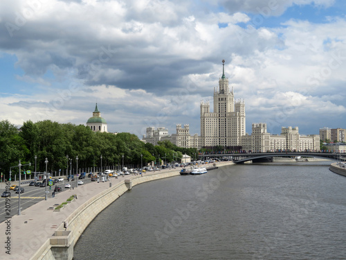 Fotobehang Moskou Moscow river and Stalin high-rise building in the center of the Russian capital. Moscow center panorama at daytime on background of cloudy sky