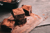 Decadent moist dark chocolate stout beer brownies cut in squares. Dark food photography concept - 207935565