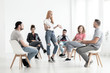 Young woman presenting role during meeting of the theater group with actors - 207937174
