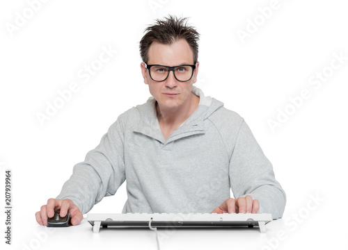Man in glasses works at the computer, isolated on white background