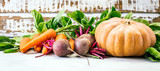 fresh vegetables on a white wooden background, beets, spinach, carrots, pumpkin, banner