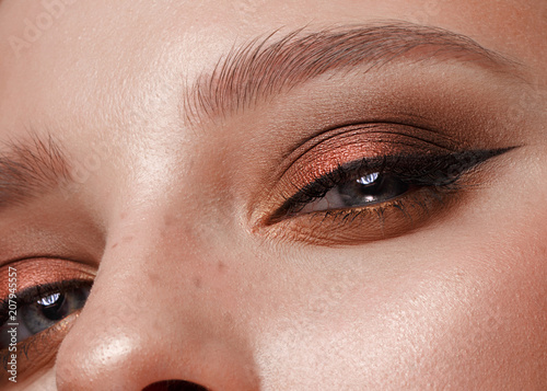 Closeup shot of female eye with color eyes shadows and eyelashes makeup