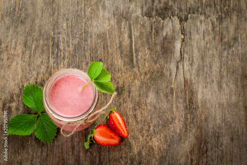 Aluminium Milkshake Strawberry smoothies in glass on wooden background. Top view. Copy space
