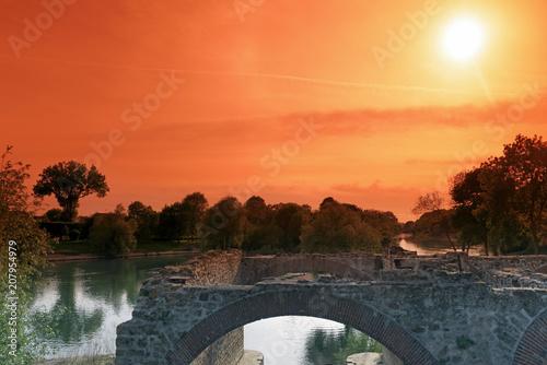 Fotobehang Koraal ruins of the Noisiel mill and Marne river in Paris suburb