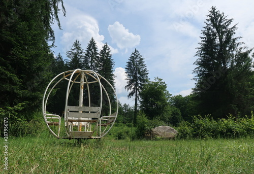 Fotobehang Lente Abandoned merry-go-round in nature