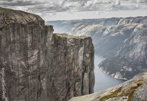 Fotobehang Donkergrijs View of the cliff face under gray clouds