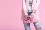 Woman in fashion clothes with handbag on pink background - 207962914
