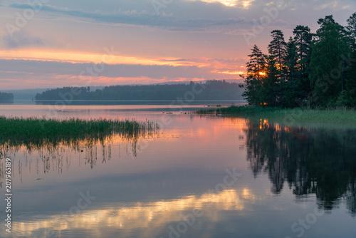 Fotobehang Zonsopgang Sunrise over a calm lake in Filipstad Sweden