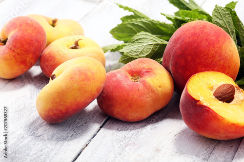 A group of ripe peaches on table