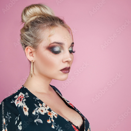 A PORTRAIT OF A SEXY YOUNG WOMAN ON A PINK BACKGROUND