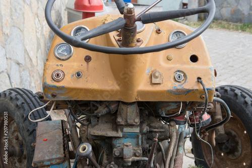Fotobehang Trekker Old vintage tractor in the village