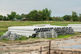 stacked of concrete, cement pipes. concrete pipes for irrigation at construction site - 207986103