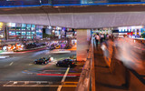 Motion blurred view of people and traffic crossing a busy intersection in Shibuya, Tokyo, Japan