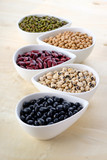 Assortment beans in white ceramic bowl, focus on the Mung Beans. Black, soybean, red kidney , black eye peas and mung beans. - 208018324
